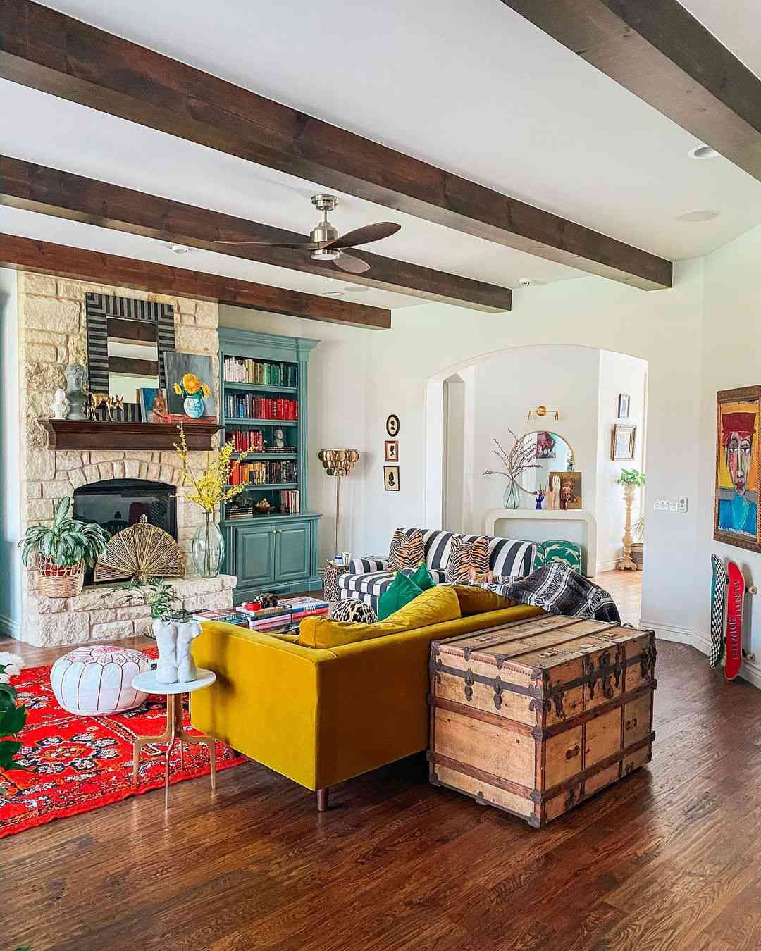 Eclectic living room with wooden beams on ceiling.