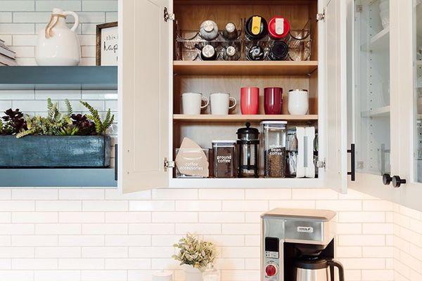 Mugs stored above a coffee maker