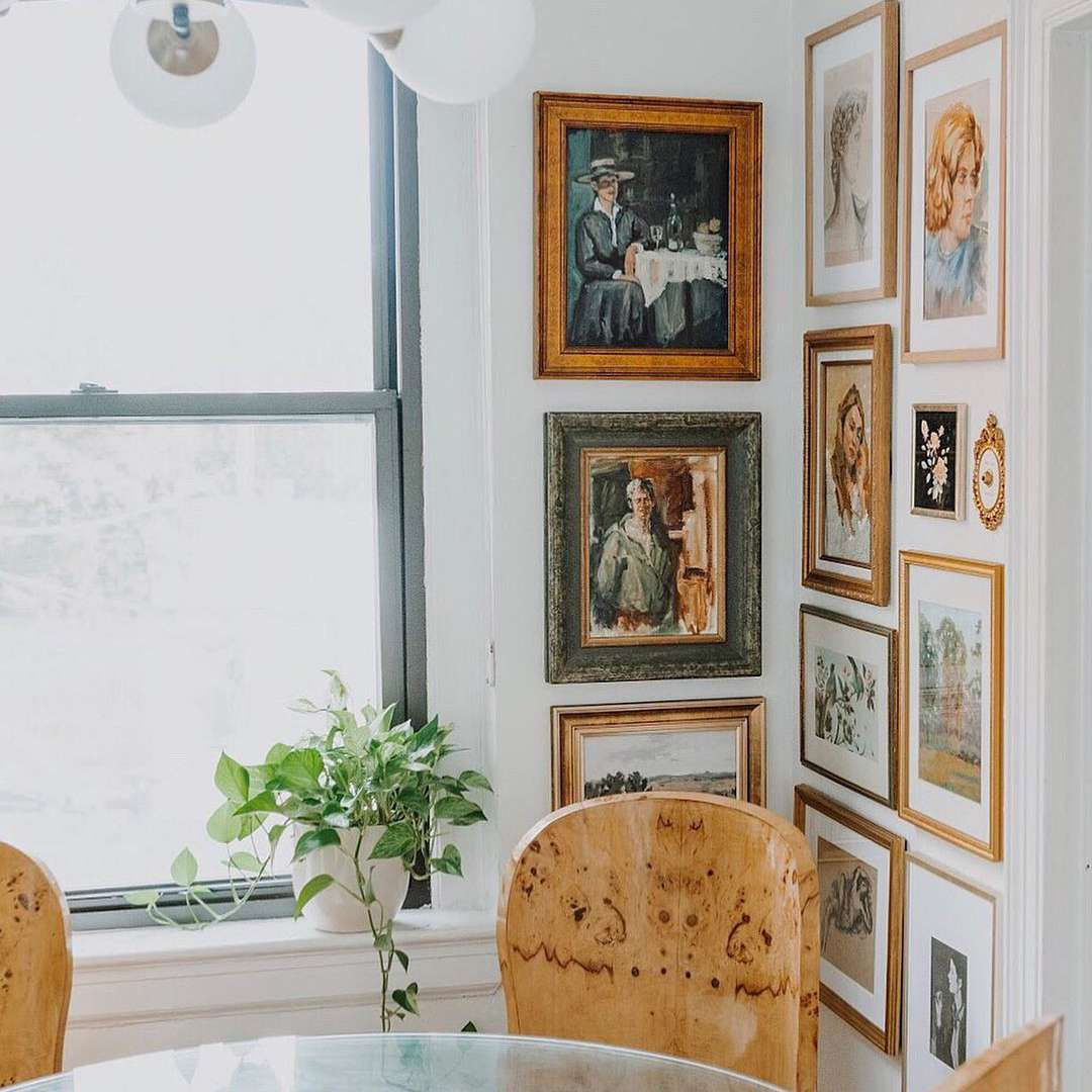 Vintage-inspired gallery wall in a kitchen corner