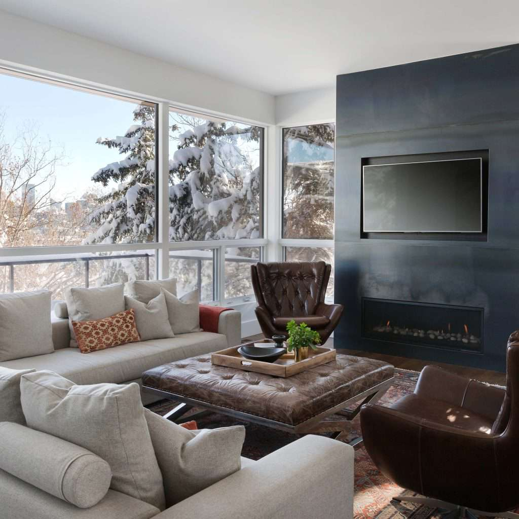 Cozy living room with leather furniture on a snowy afternoon