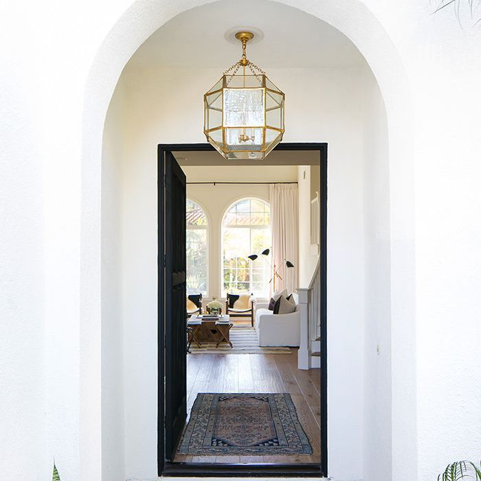 Arched entryway features rectangular rug