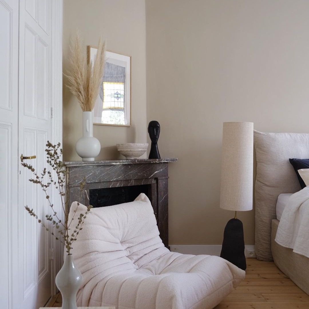 Modern Scandi bedroom with large lampshade on small base.