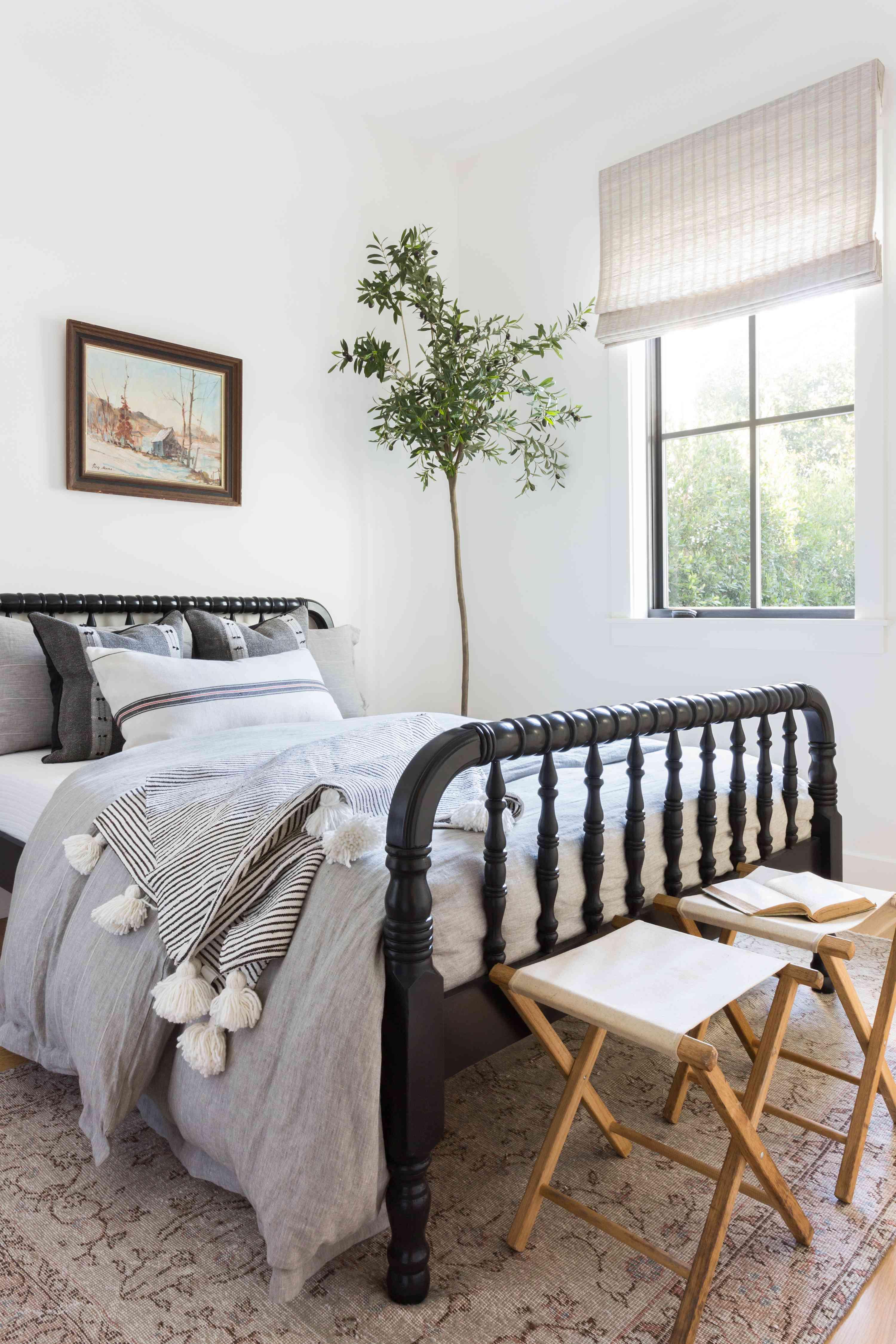 Coastal bedroom with black bed frame.