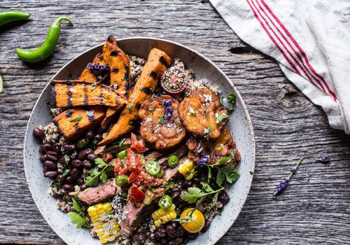 brazilian steak and grilled sweet potato fry quinoa bowl with spicy coconut tomato sauce