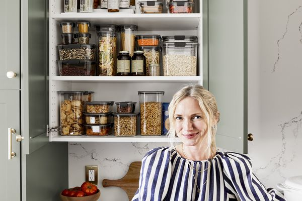 Emily Henderson in front of an organized pantry.