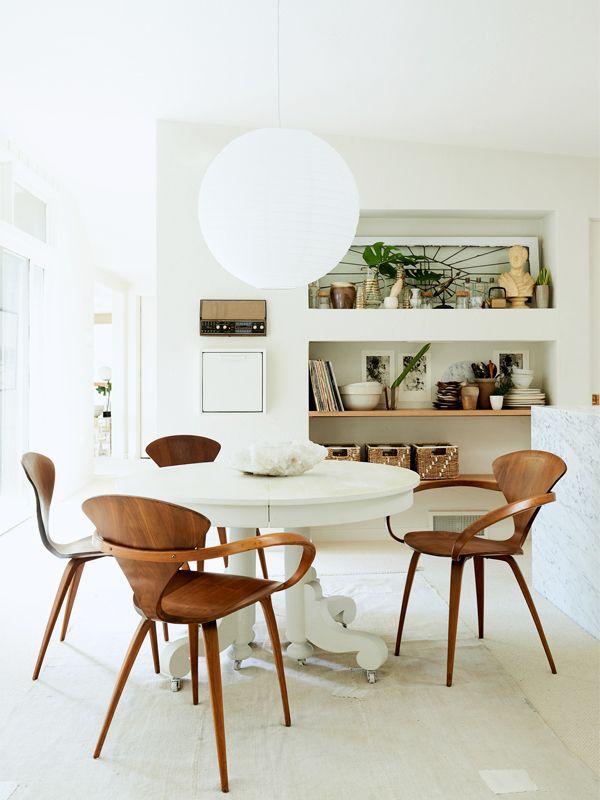 Scandinavian dining room with paper lantern.