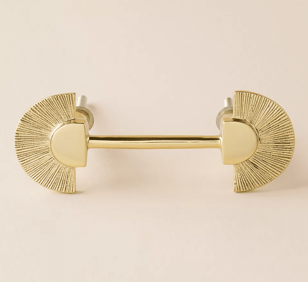 An ornate brass drawer pull, currently for sale at Anthropologie