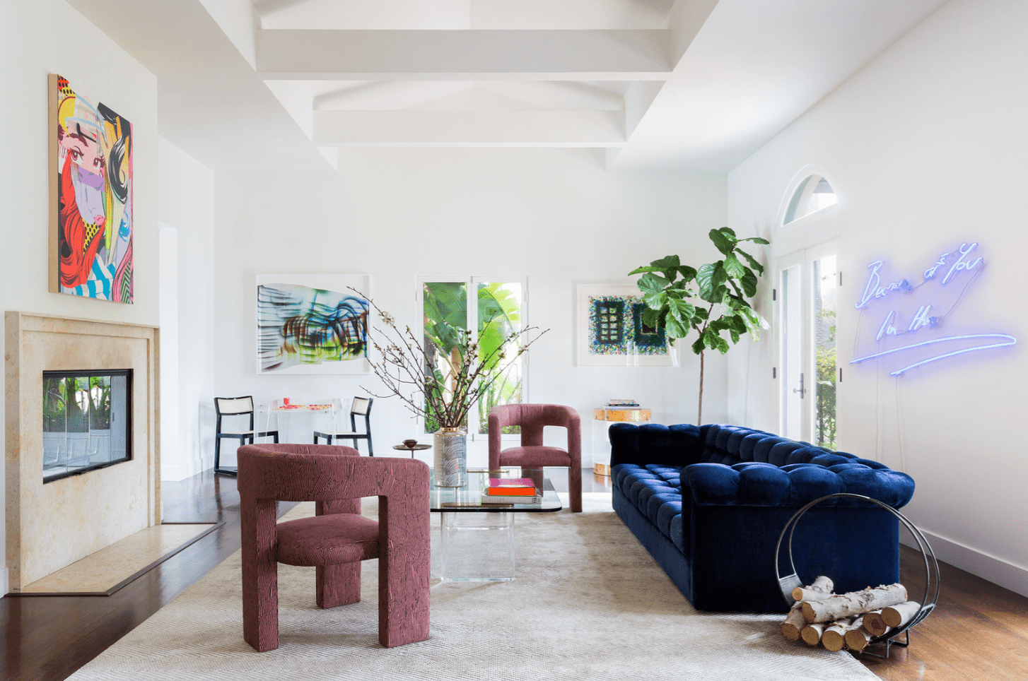 A living room with a navy couch and two maroon lounge chairs that have been laid out asymmetrically