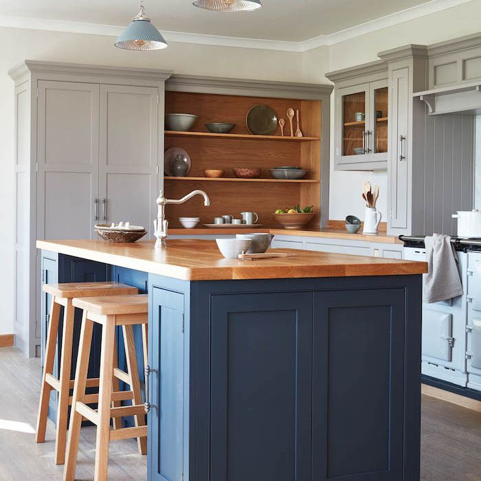 gray and blue farmhouse kitchen with wooden counter and stools