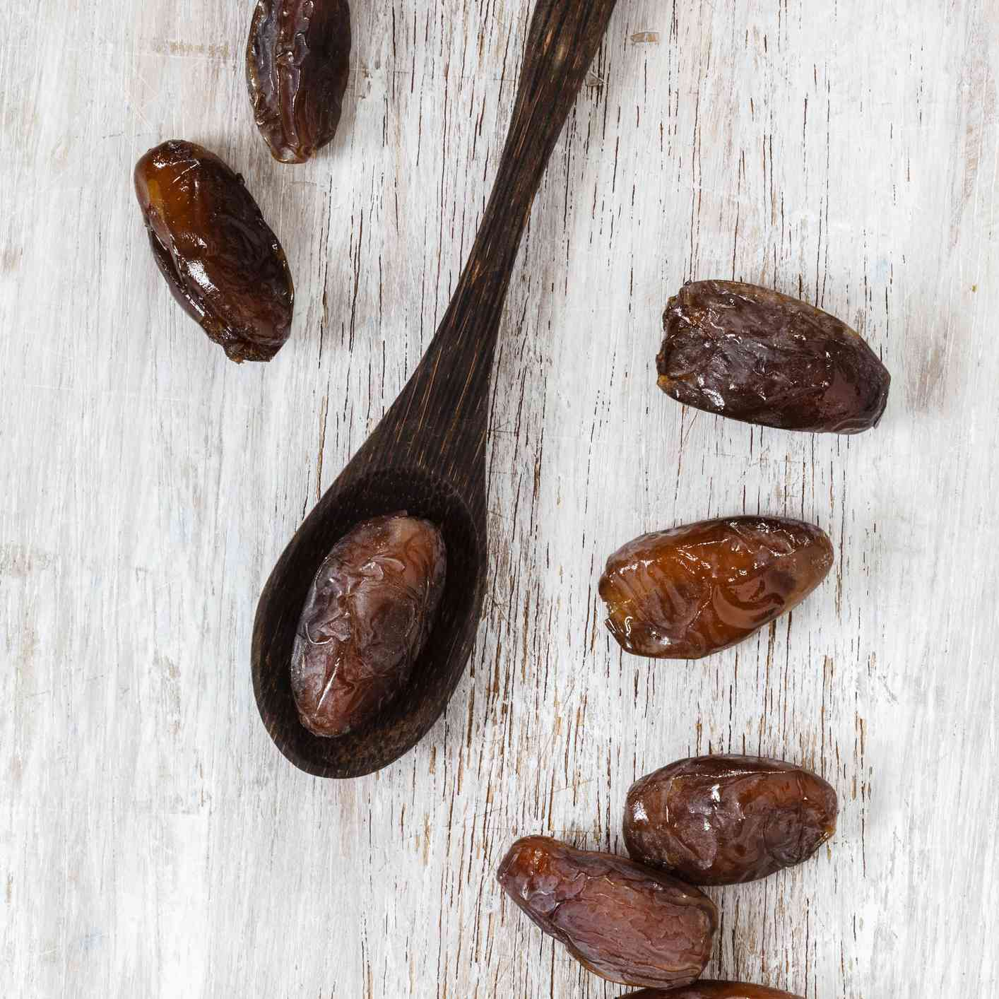 Dates and a wooden spoon