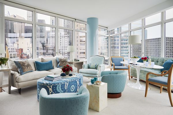 Large city apartment with blue classic furniture.
