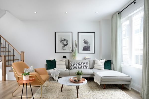 Soft, neutral living space with sectional and leather chair.