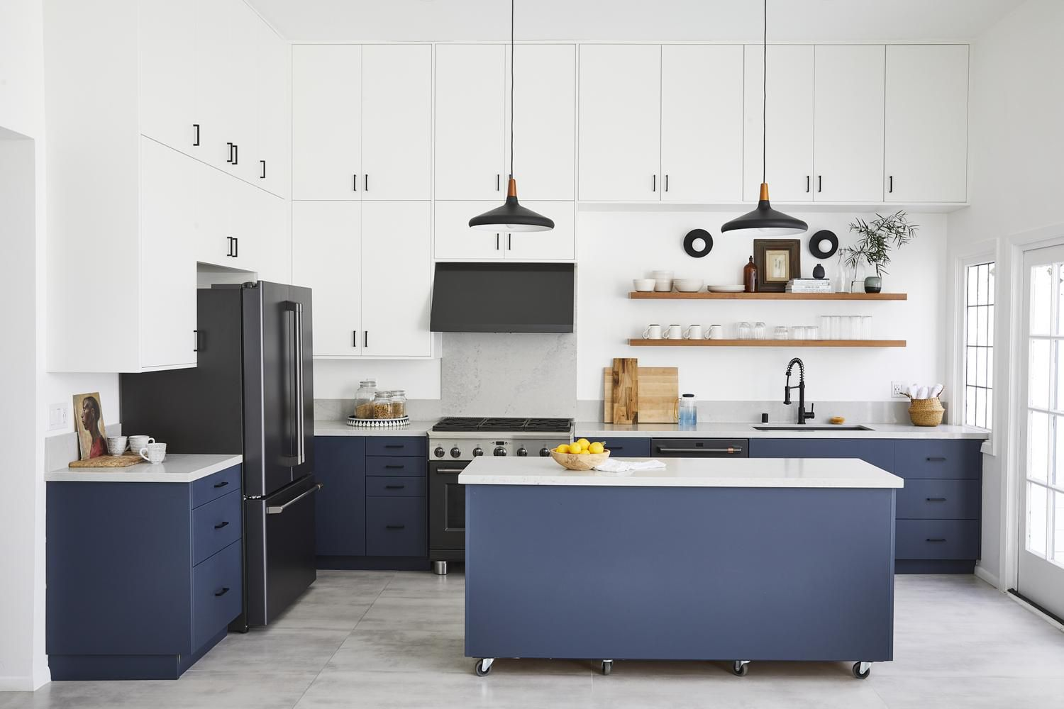 A two-tone kitchen with white and navy IKEA kitchen cabinets