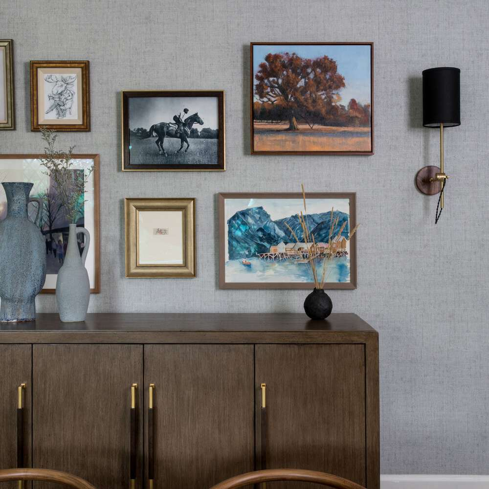 Credenza with artwork and sconces