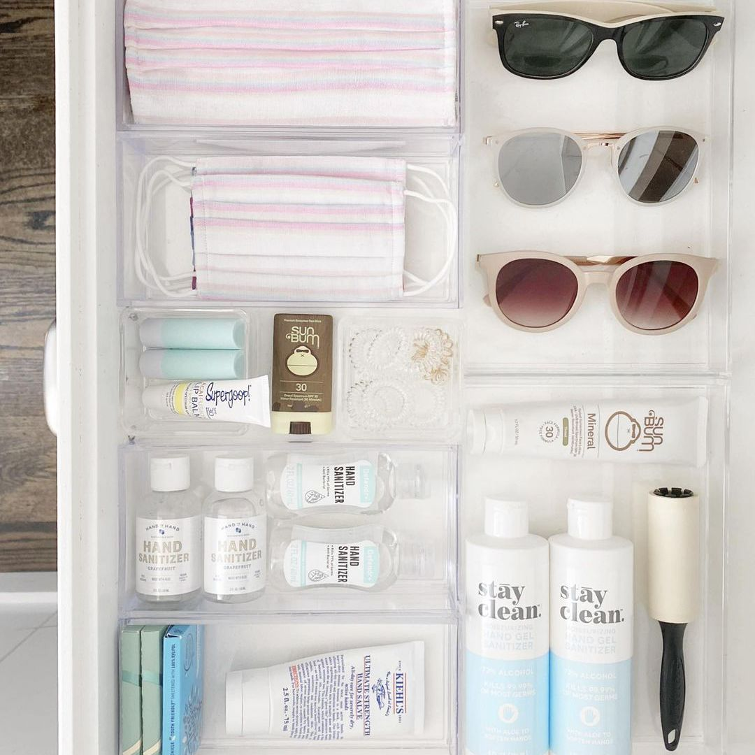 Neat drawer filled with masks, sunglasses and skincare.