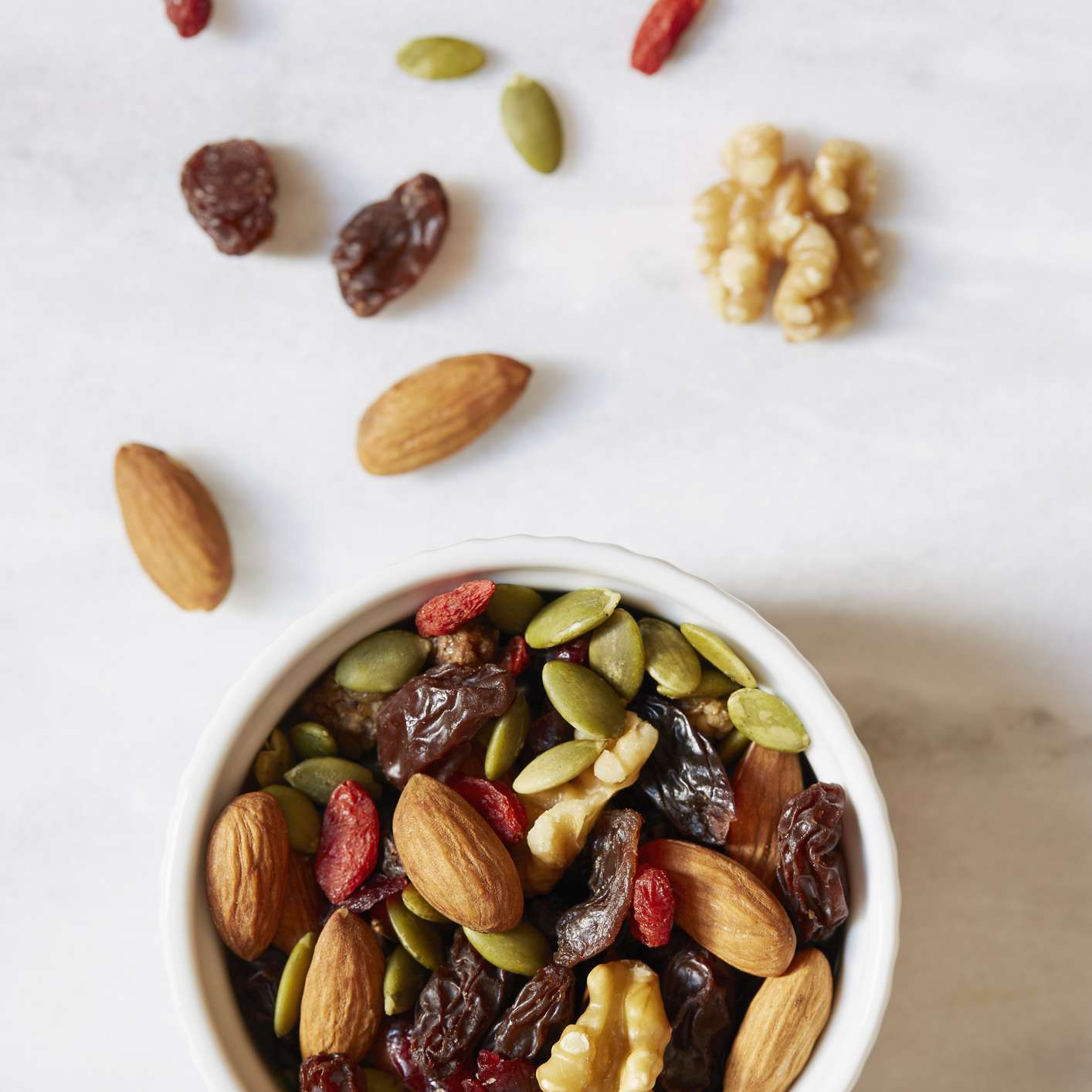 Bowl of nuts and seeds, including almonds and walnuts