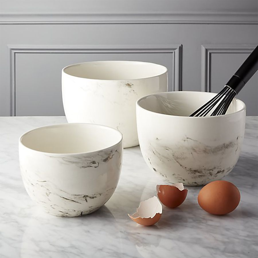 Ceramic bowls with whisk.