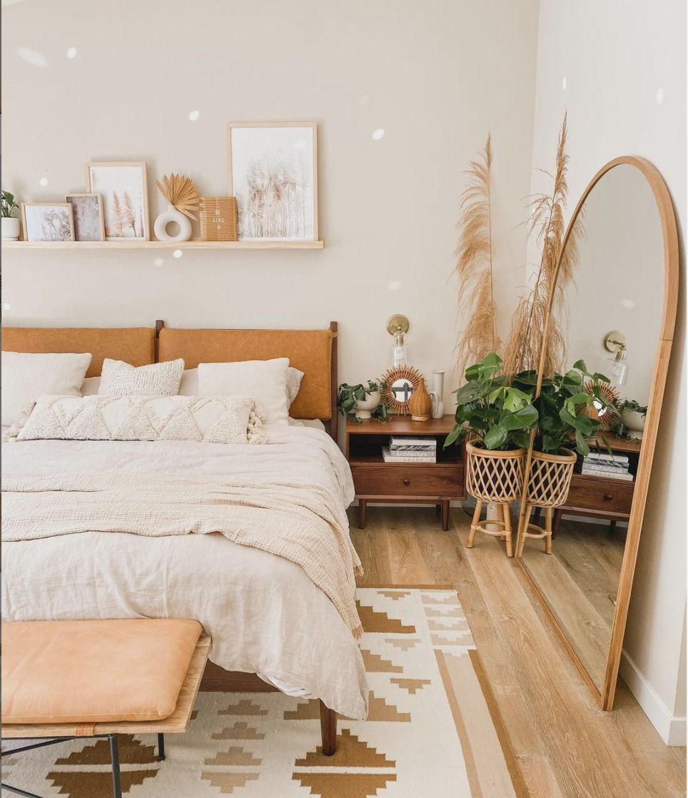 bedroom with warm tones, floor length bedroom by the bed