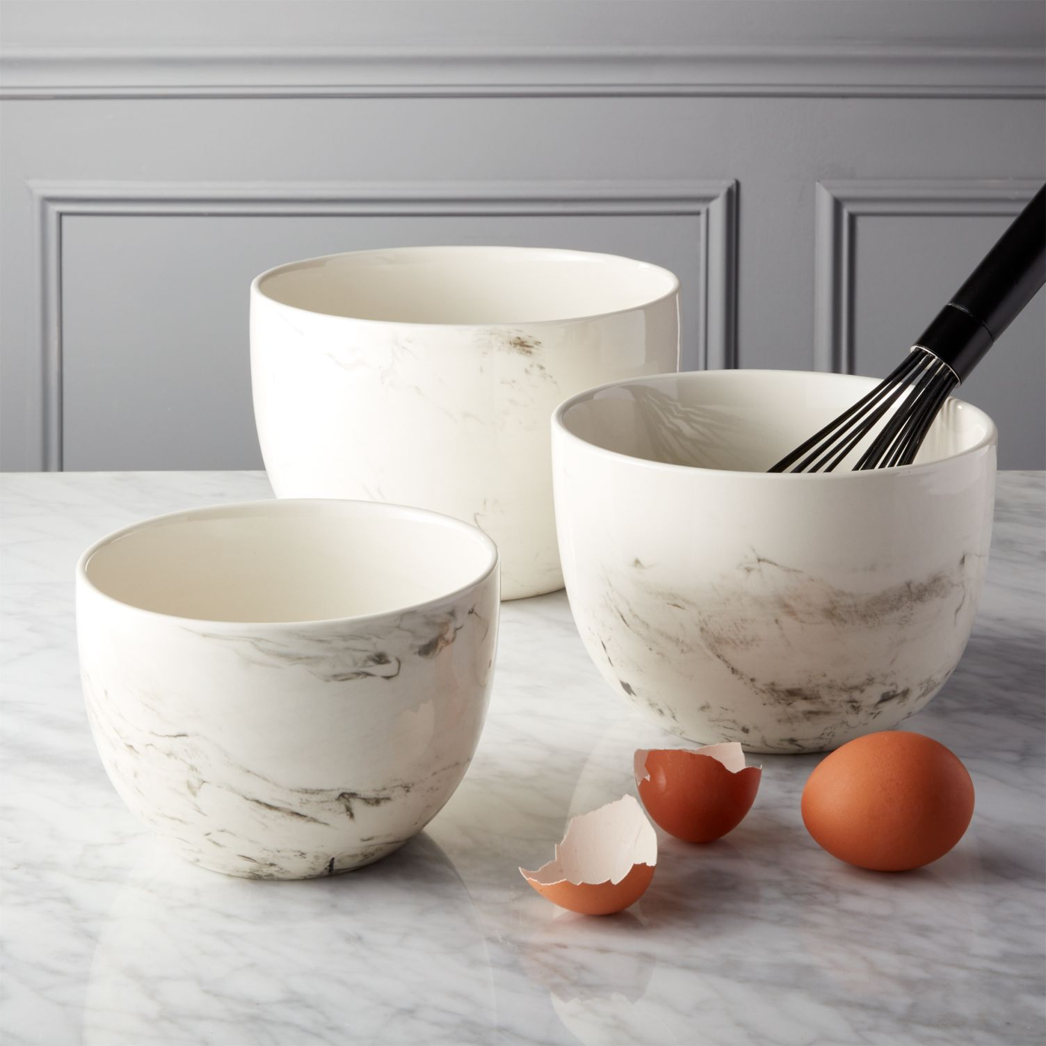 Set of three white stoneware mixing bowls in small, medium, and large—all by CB2.