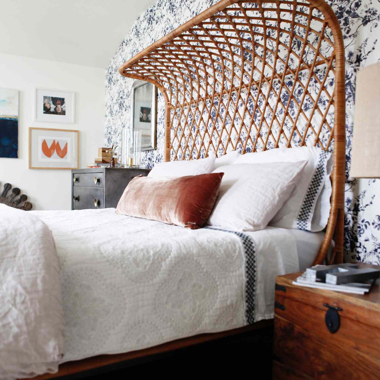 Maximal luxe bedroom with navy wallpaper