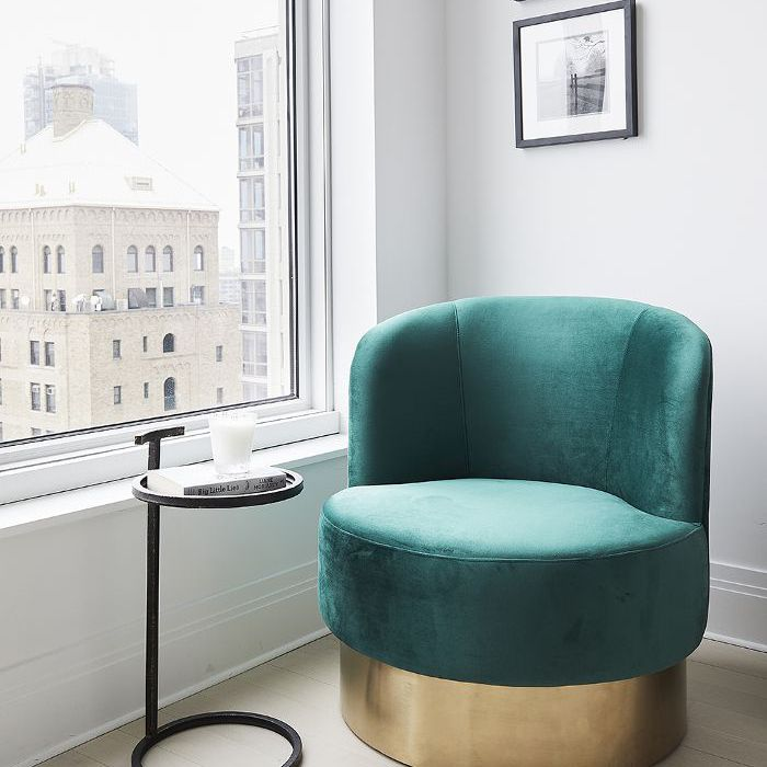 Bright green chair in Ashley Benson's New York City Apartment