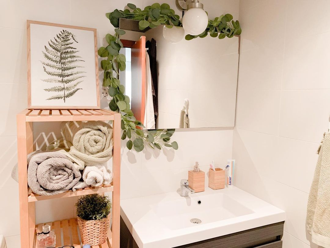 Bathroom with a light above mirror