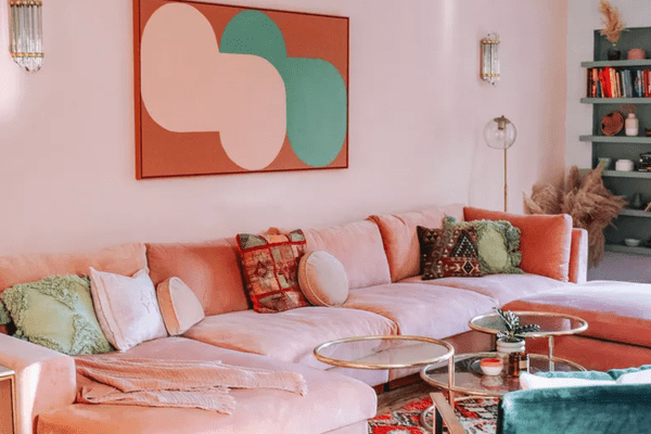 living room with pink wall and pink sofa