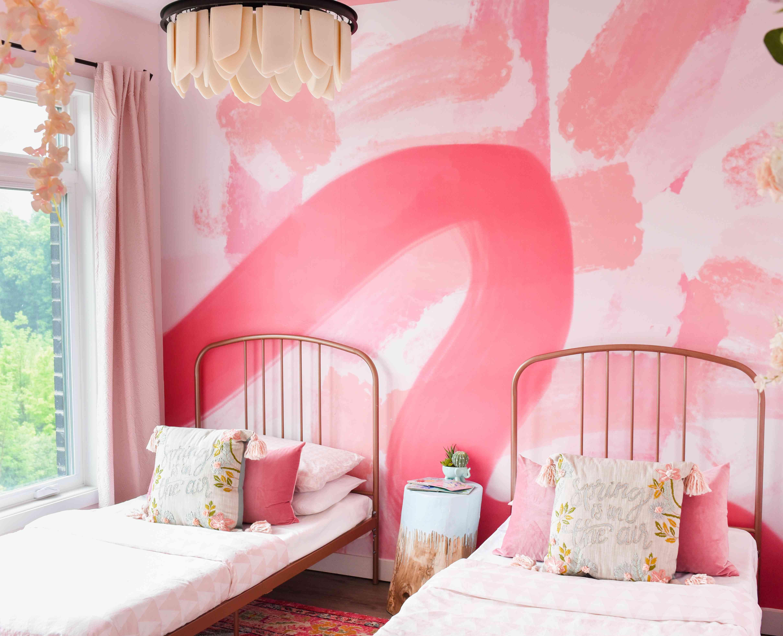 Whimsical girls pink bedroom.
