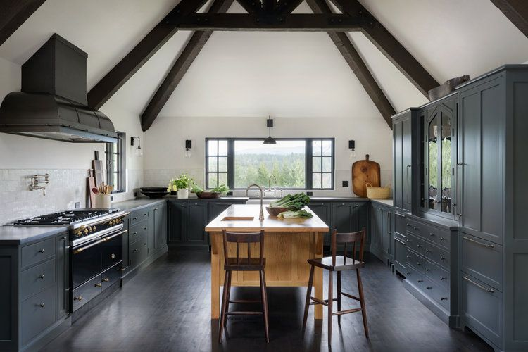 Kitchen with vaulted ceilings and dark wood floors