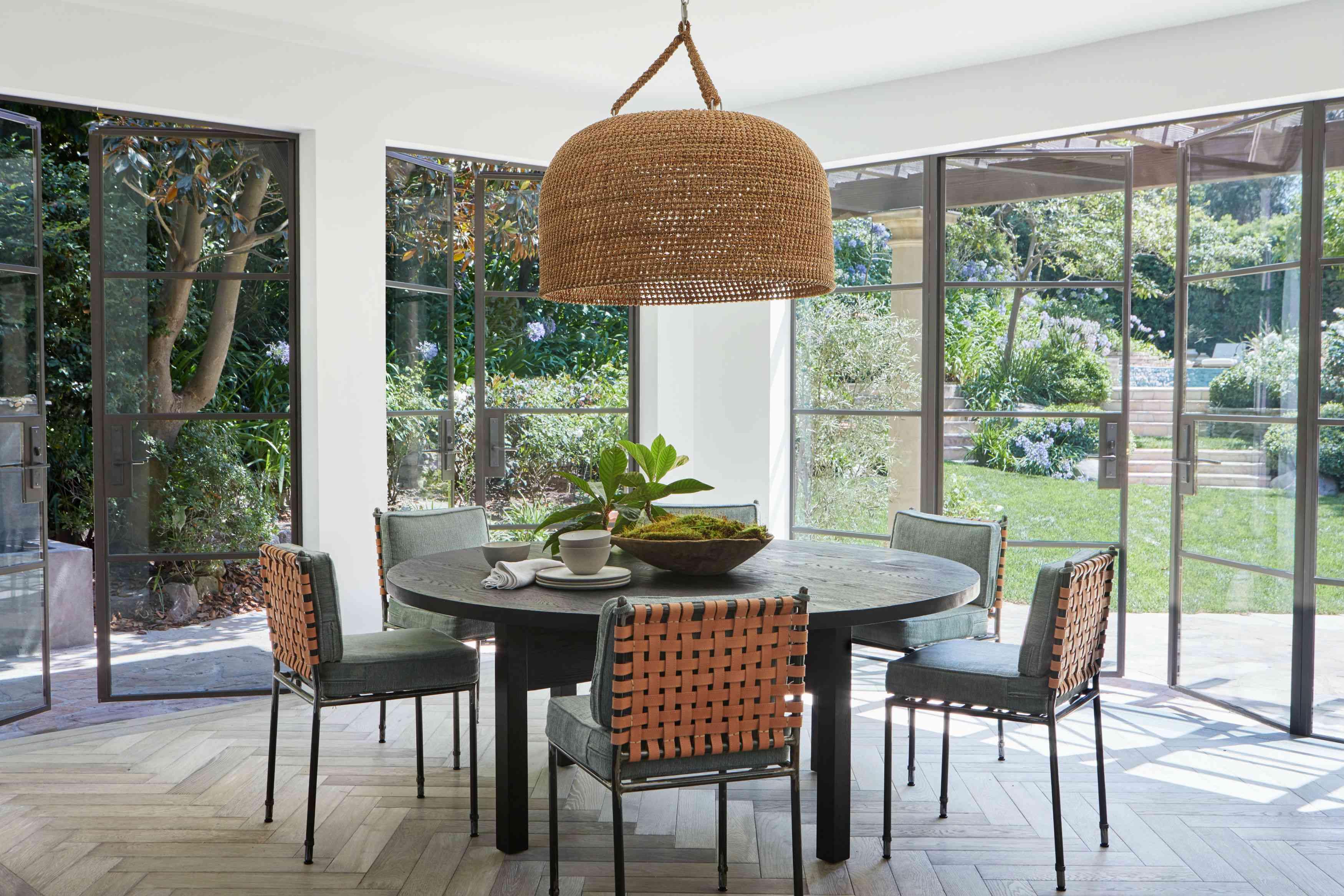 Kitchen Table Beneath a Woven Pendant Light