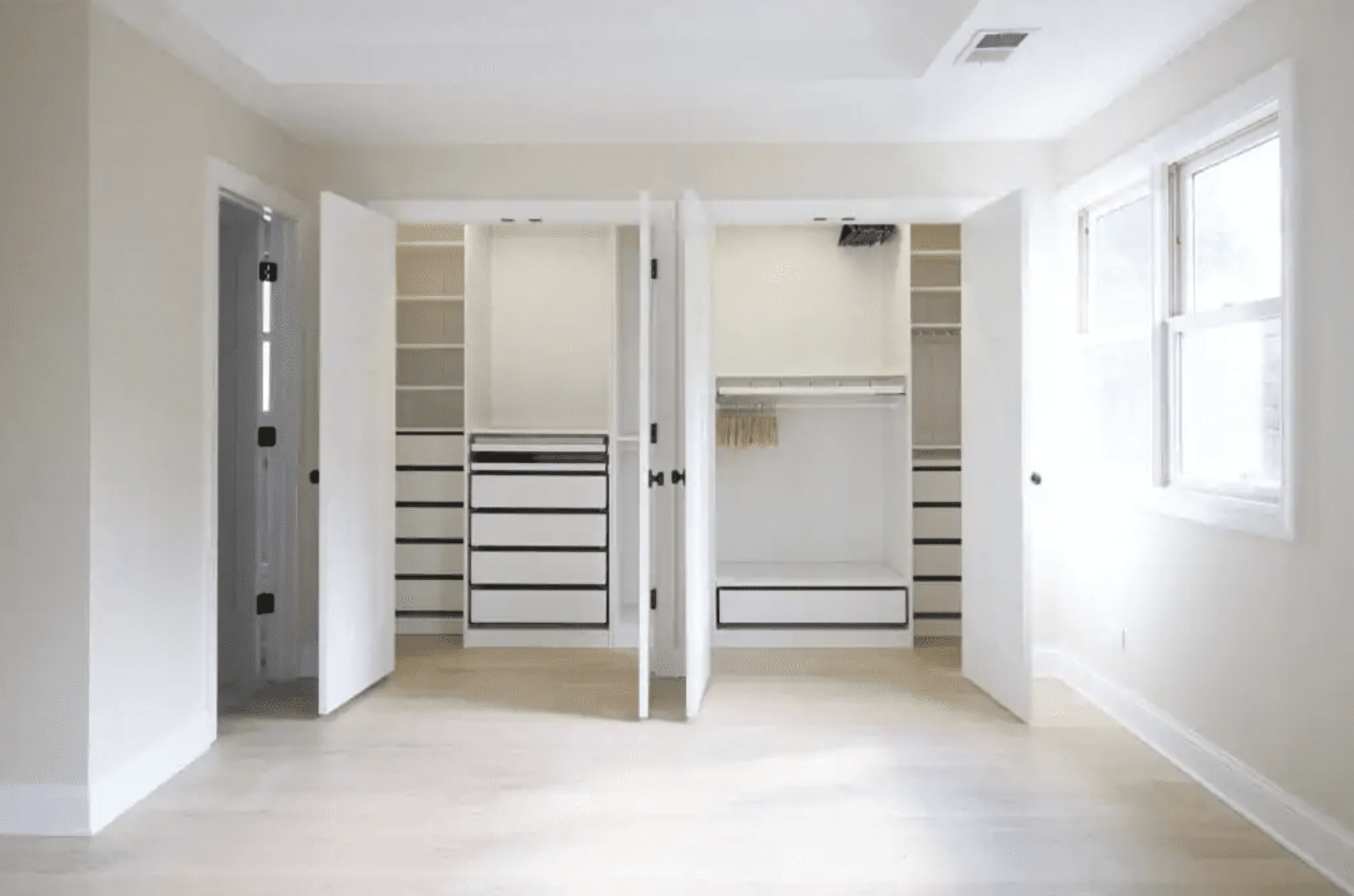 A renovated IKEA closet without clothes in it.
