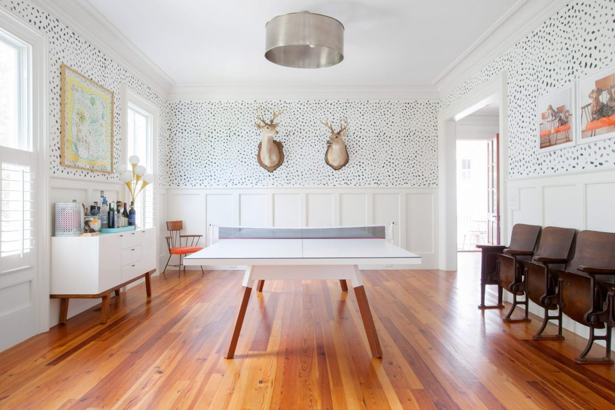 Whimsical room with wood wainscoting