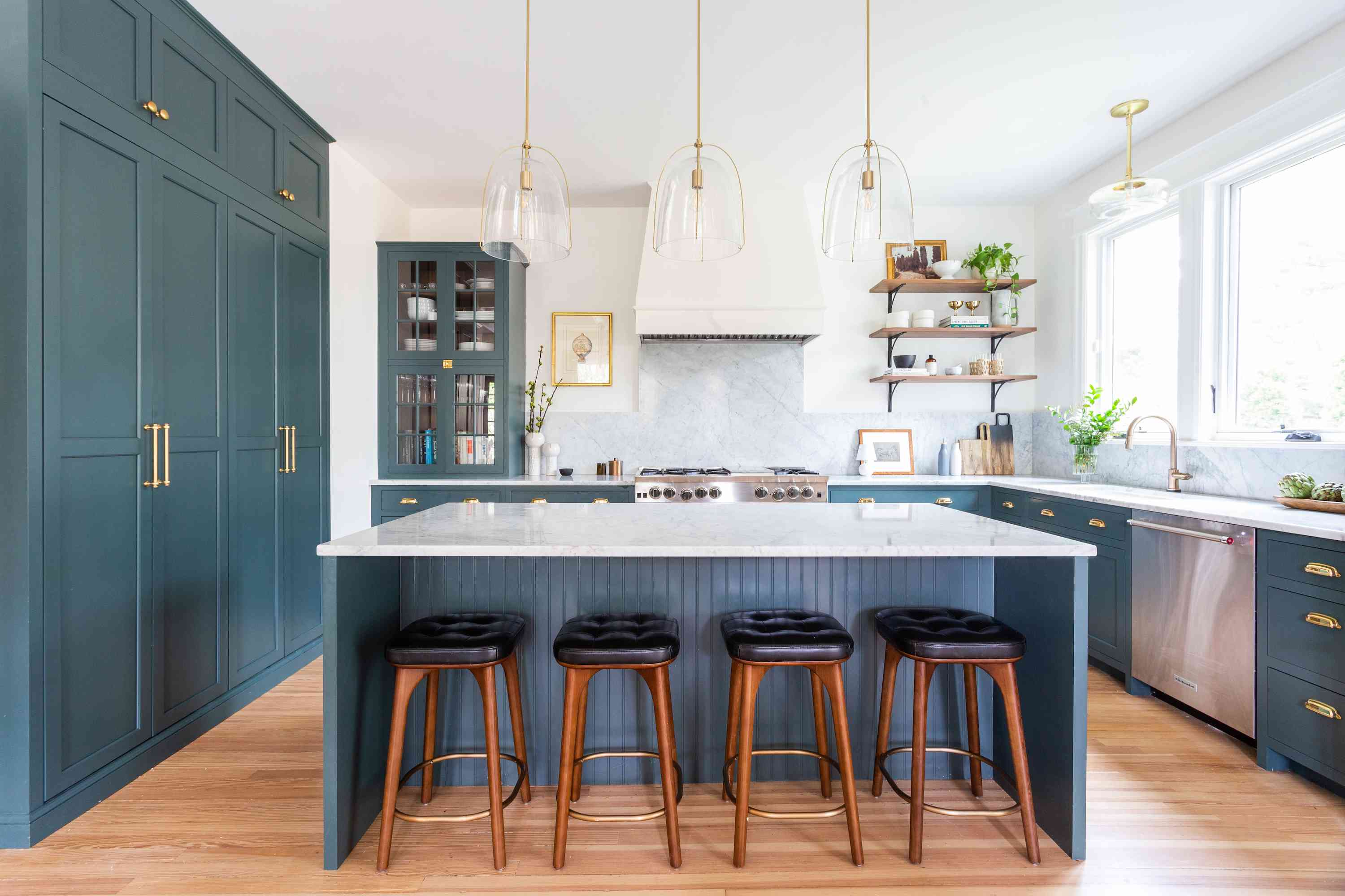 Classic kitchen with teal cabinetry.