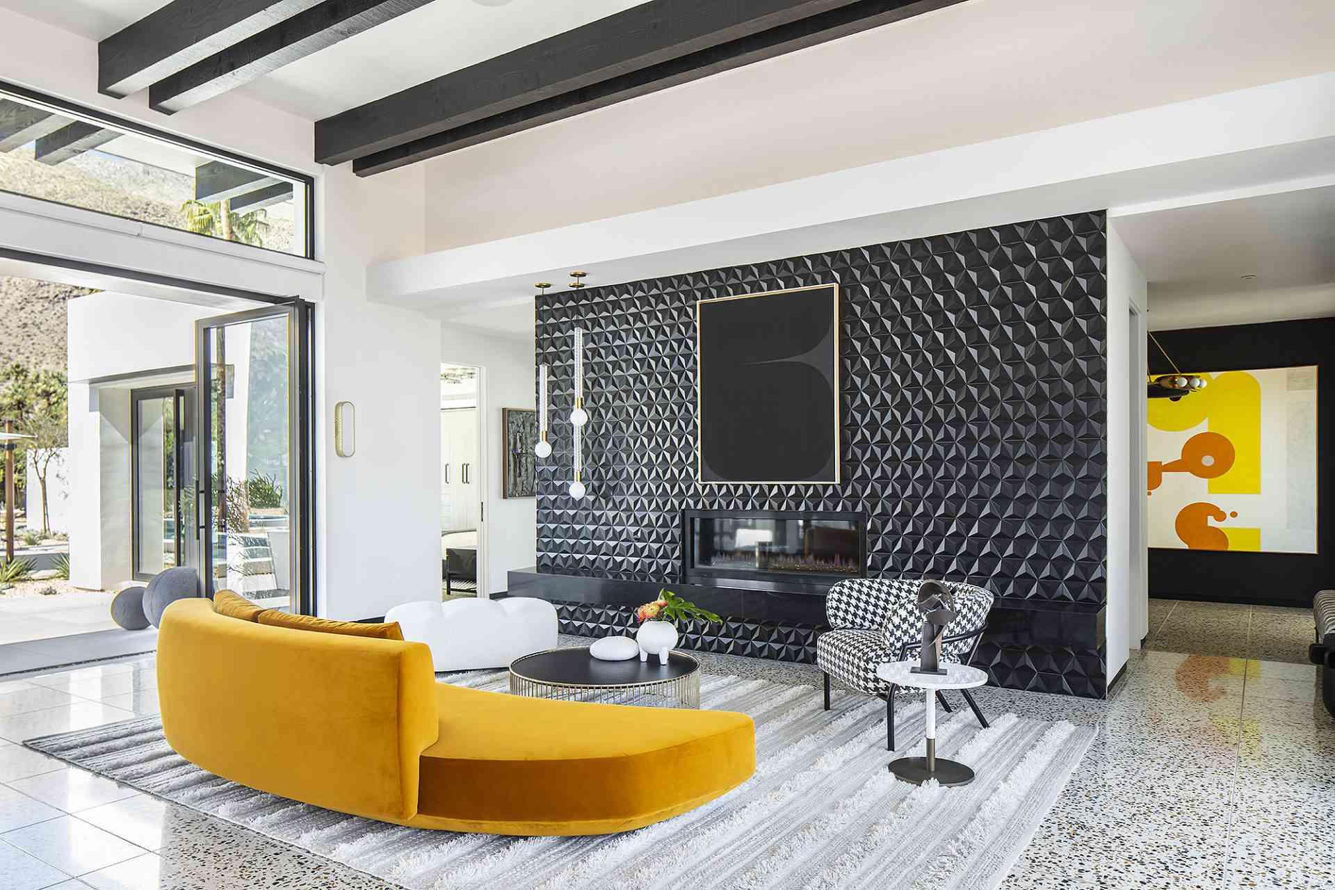 Bold black and white living room with orange sofa.