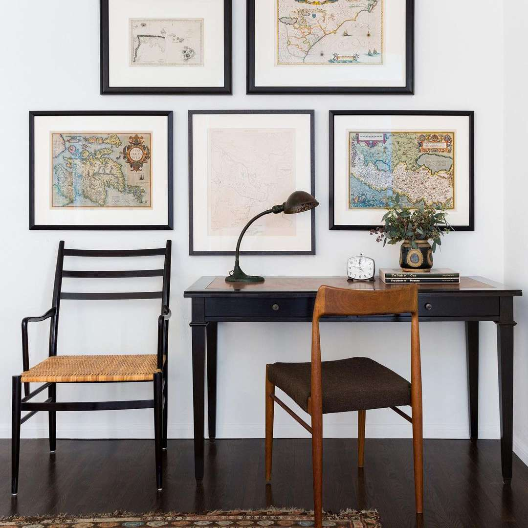 Gallery wall of vintage maps
