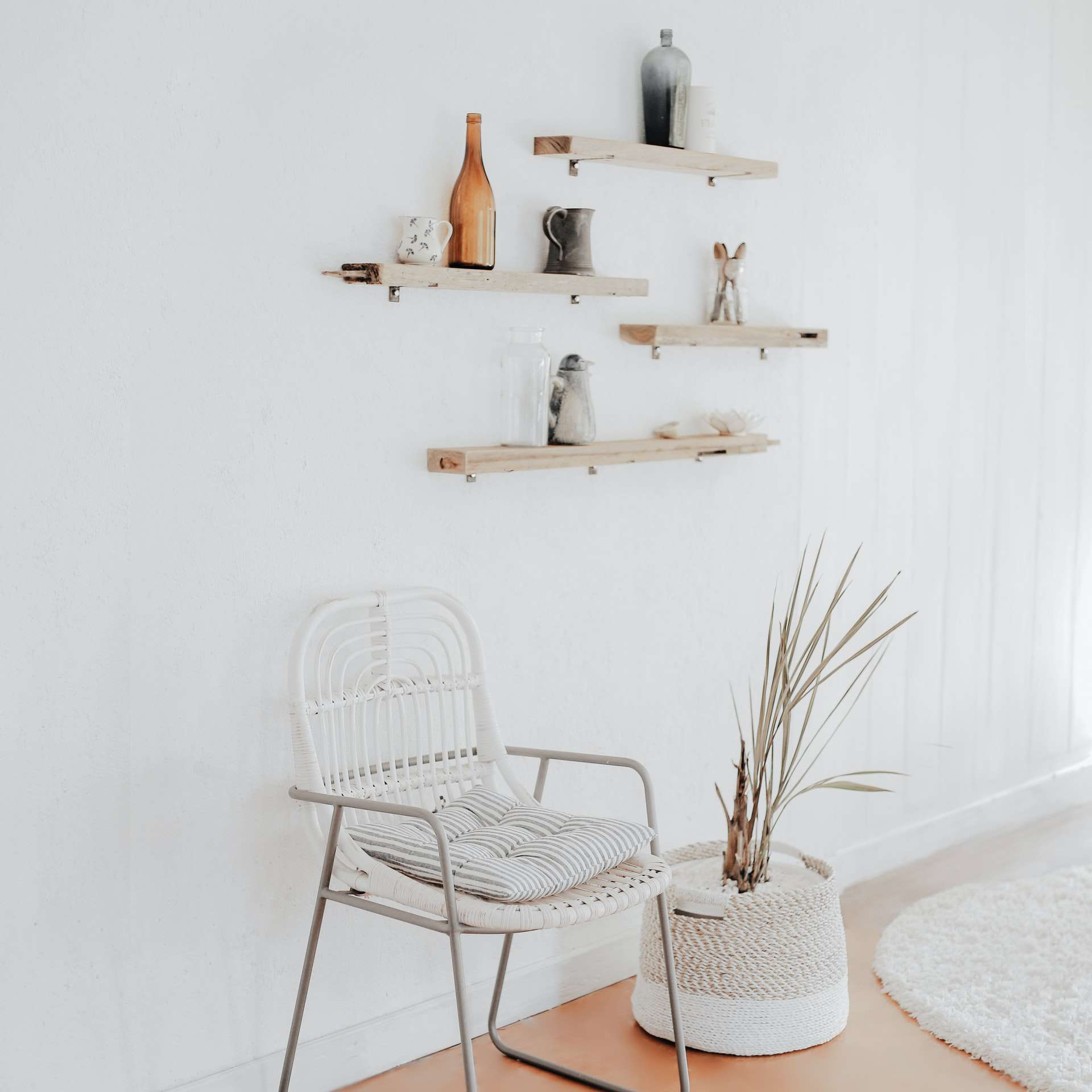 minimalist room with chair and shelving