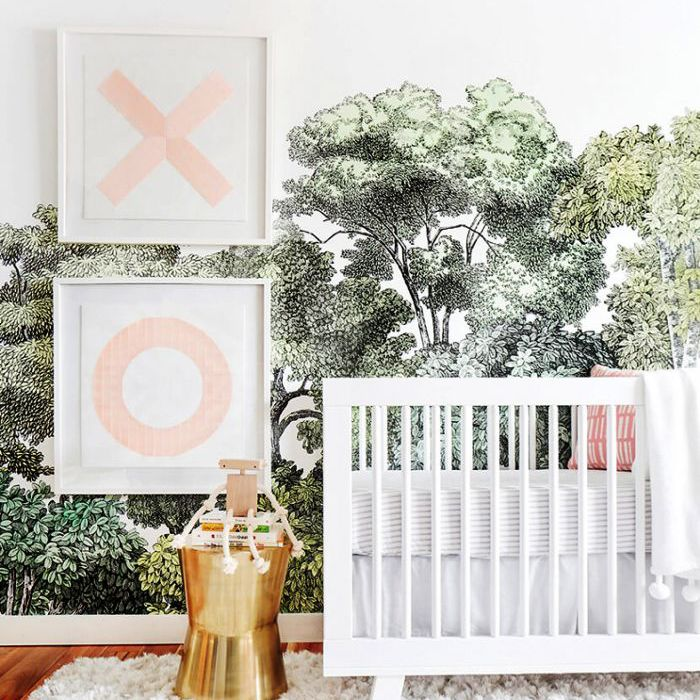 nursery with crib and forest etching wallpaper
