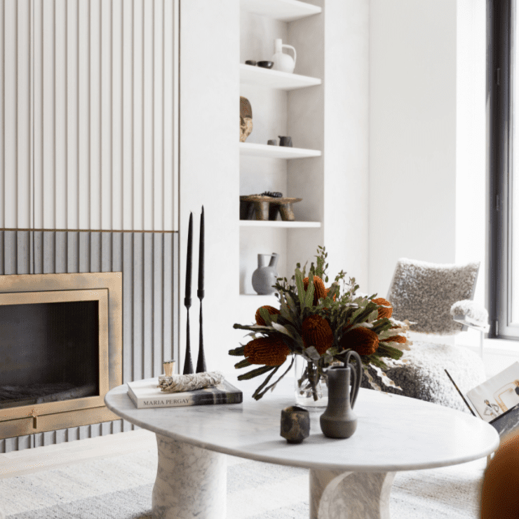 best living room ideas - sculptural elements with statement fireplace