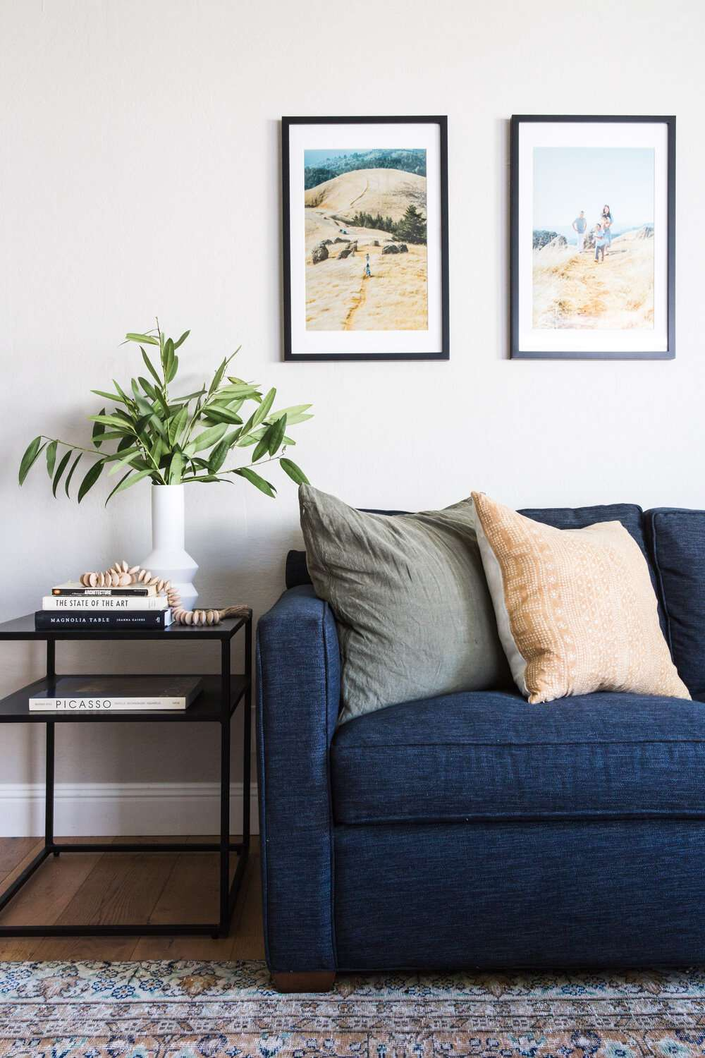 Living room with large family photos on the wall