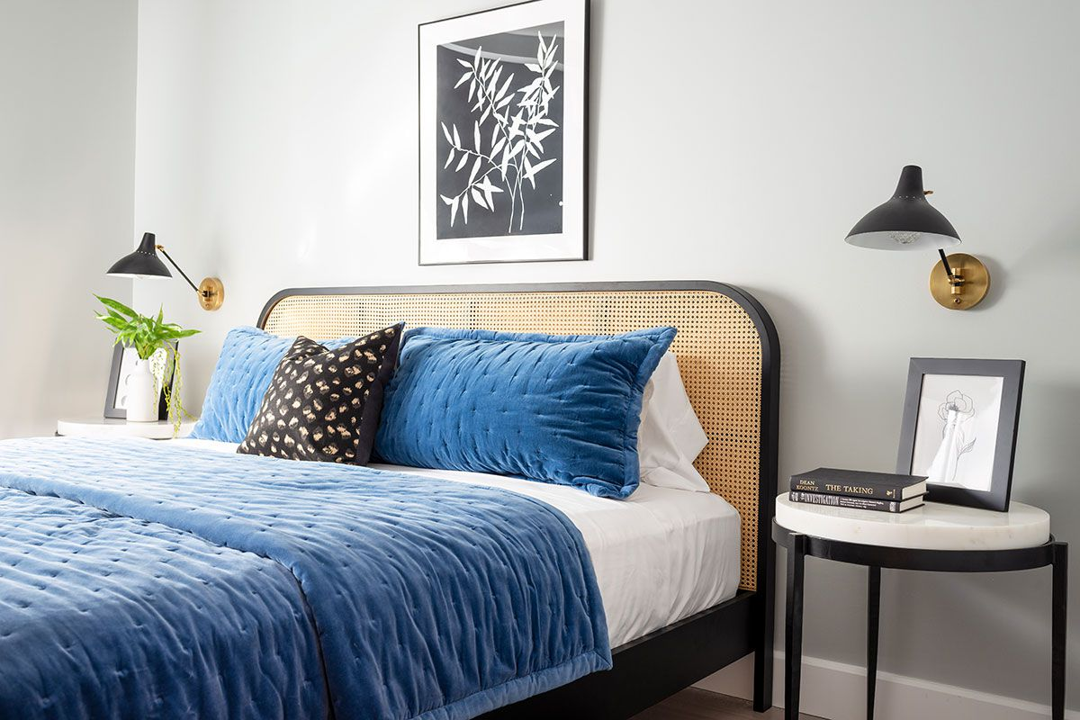Black and white bedroom with blue bedding.