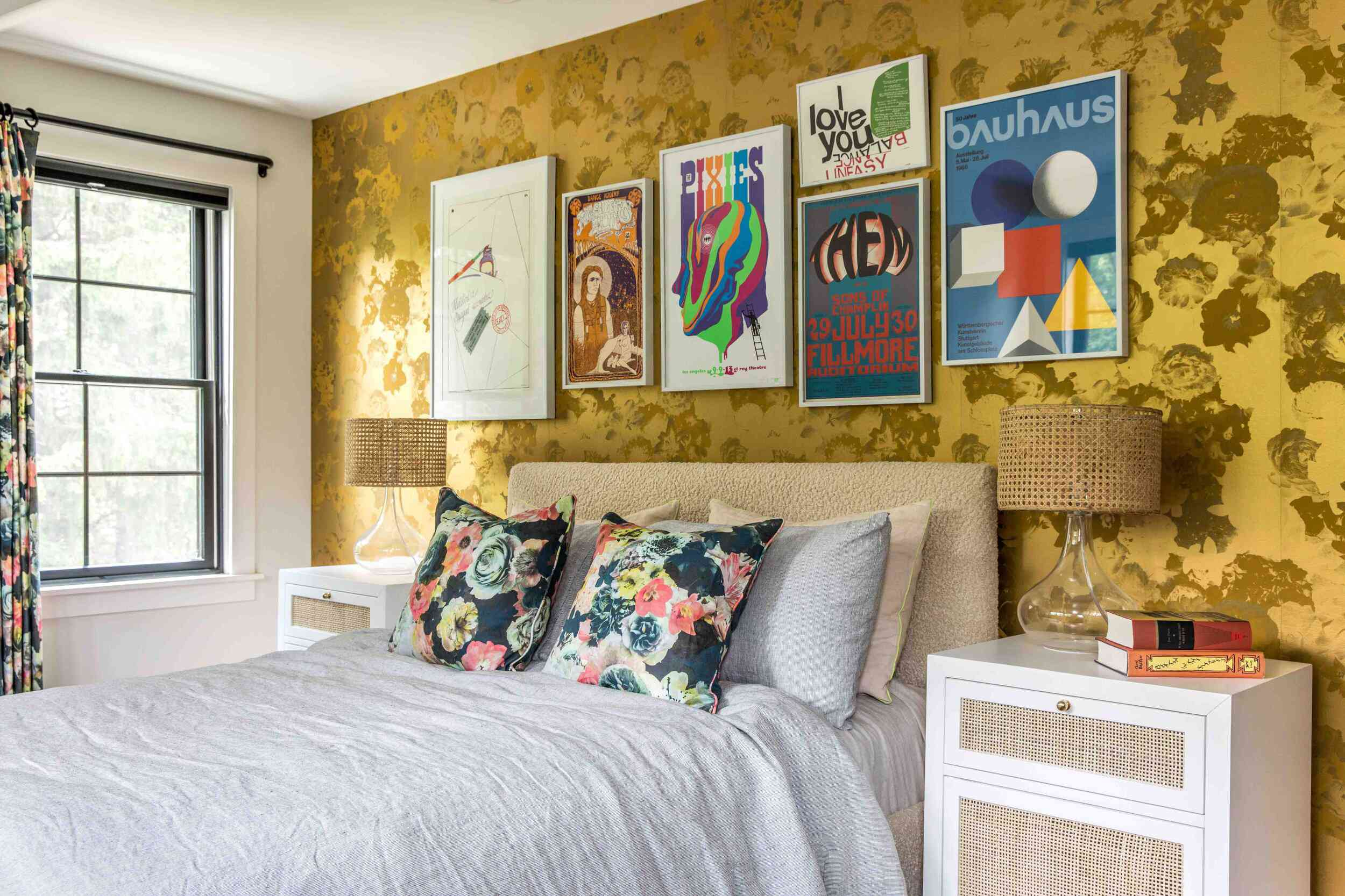 A bold bedroom with floral curtains and matching pillows