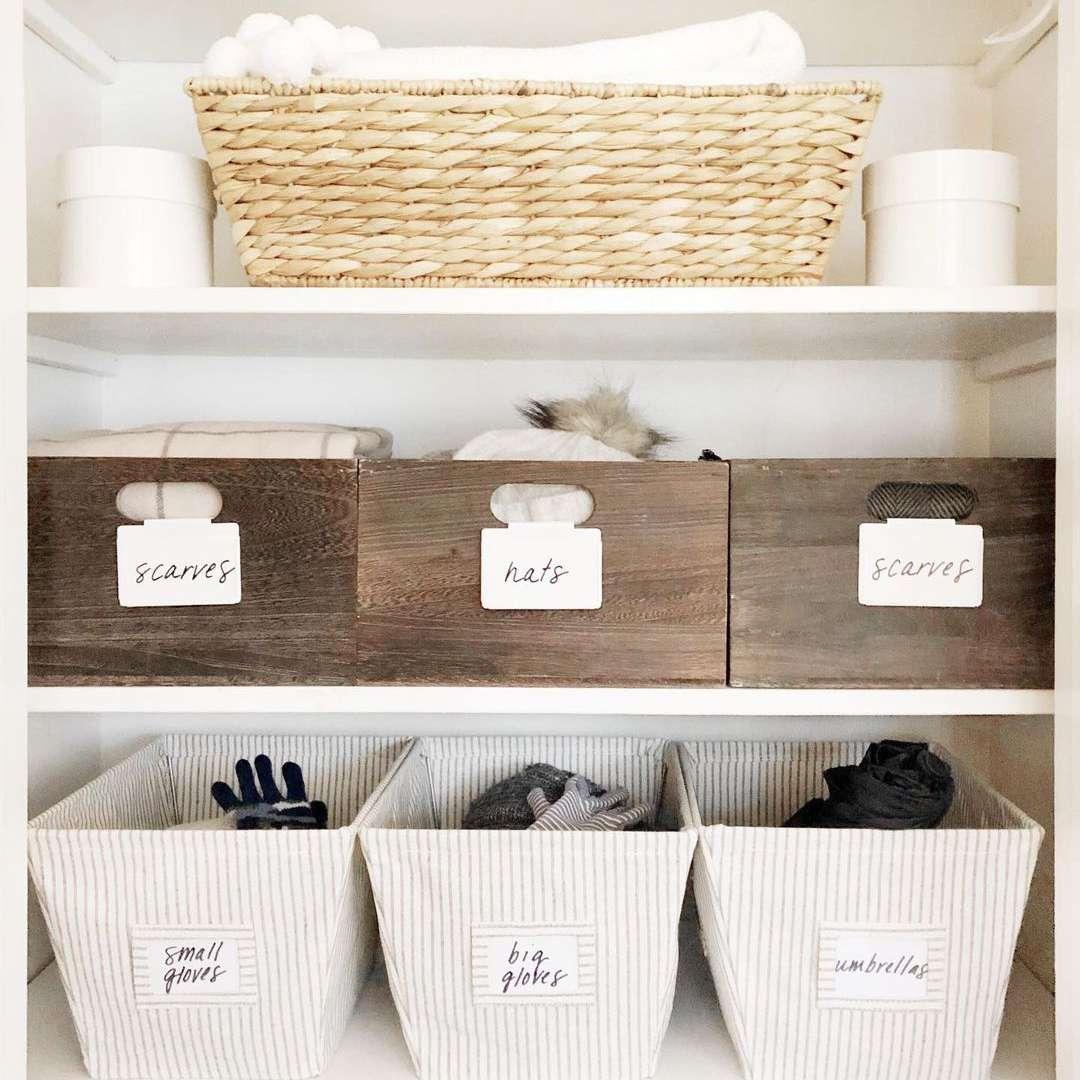 hall closet with baskets and bins