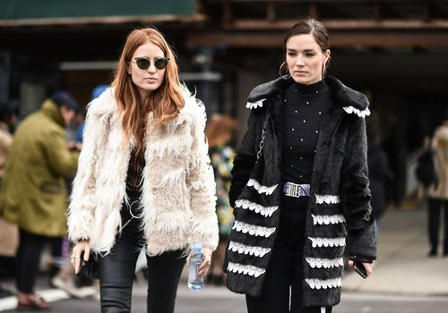 two serious women walking in the street