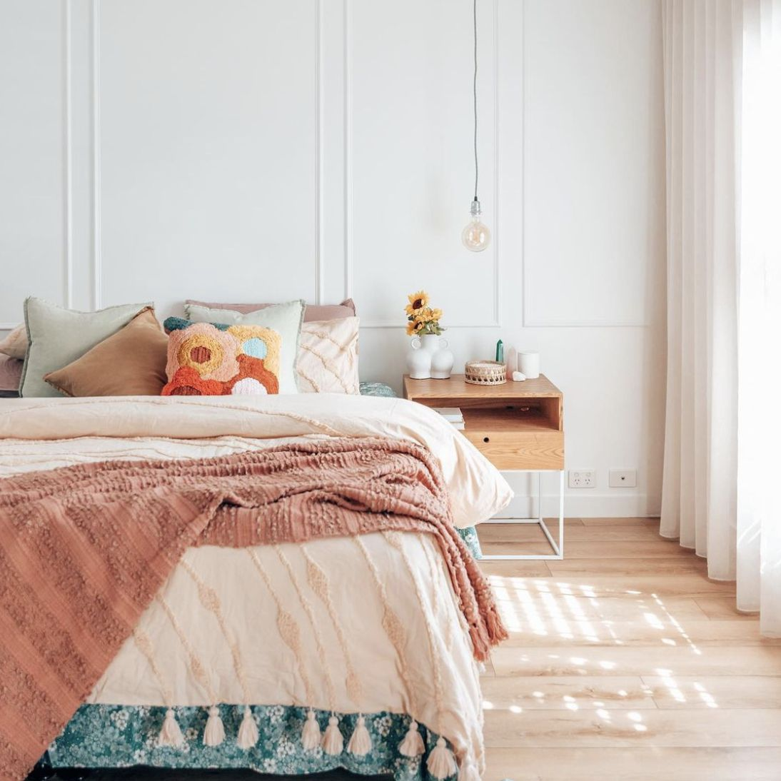 bedroom with different textures and layer of pink blankets