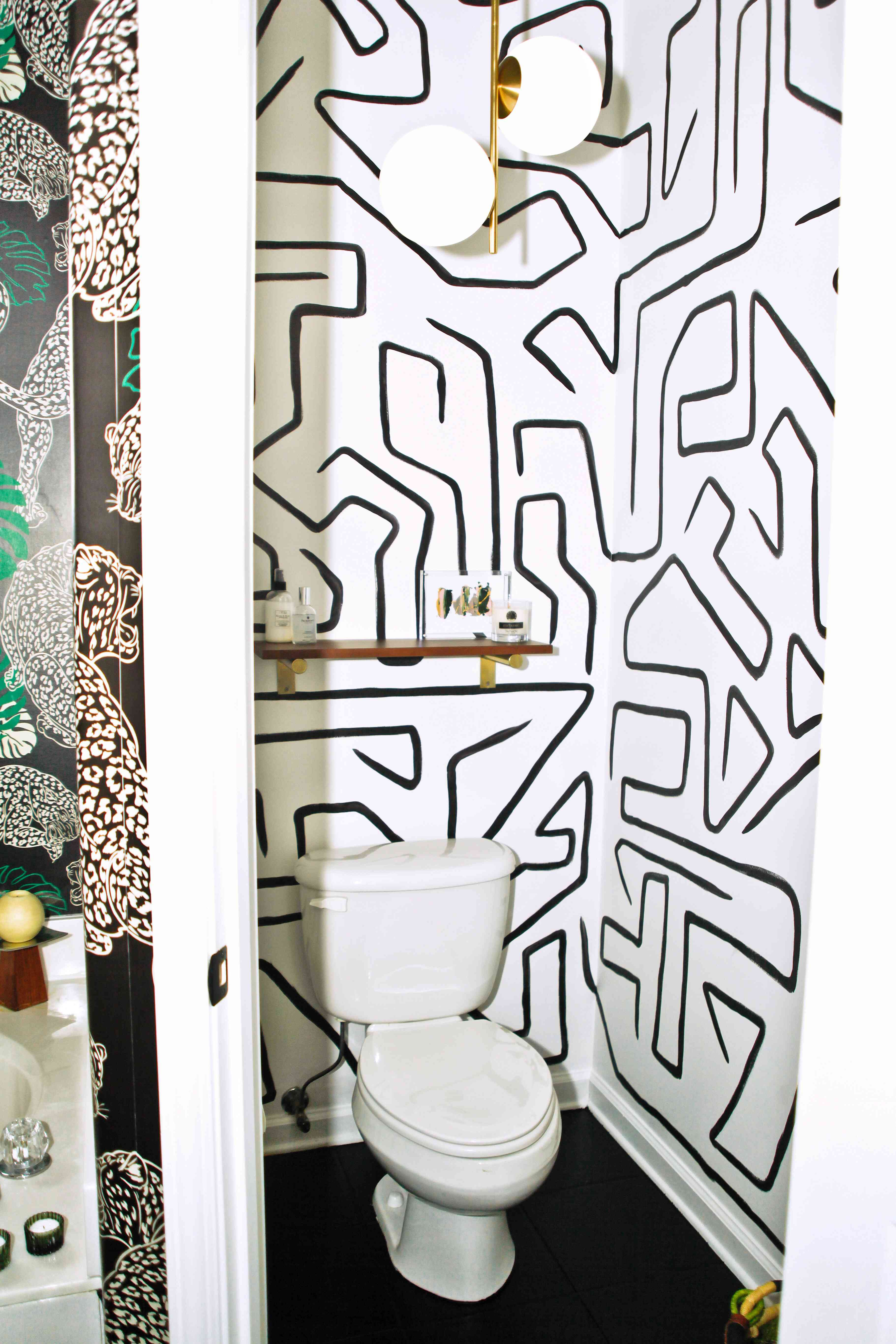 one room i'll never forget - bathroom with wallpaper and floating shelf storage