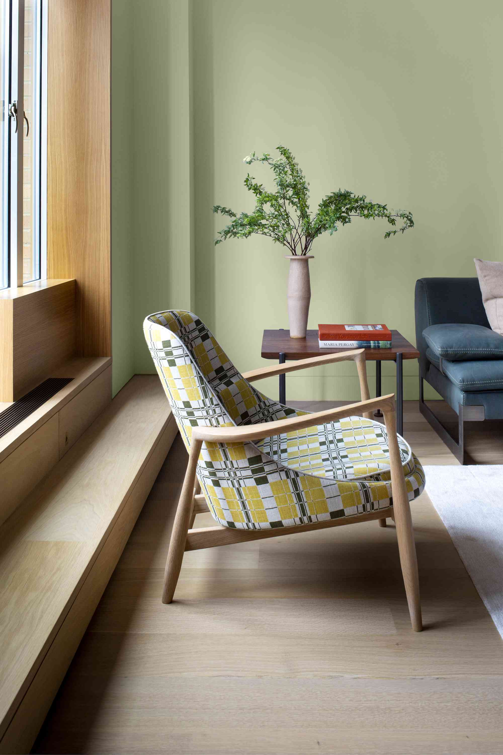 Funky patterned chair in living room painted Olive Sprig.
