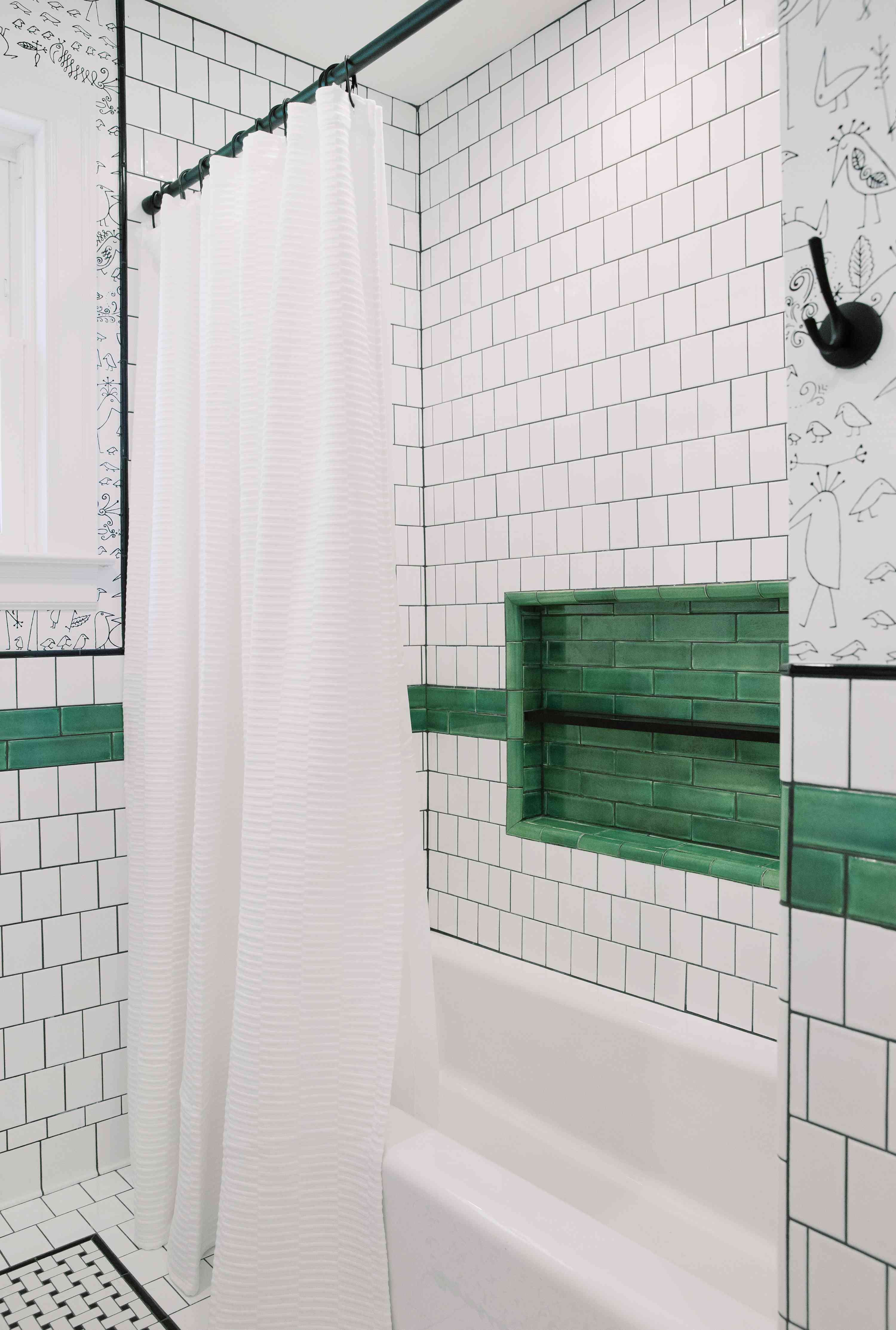 Green tile cutout in shower.