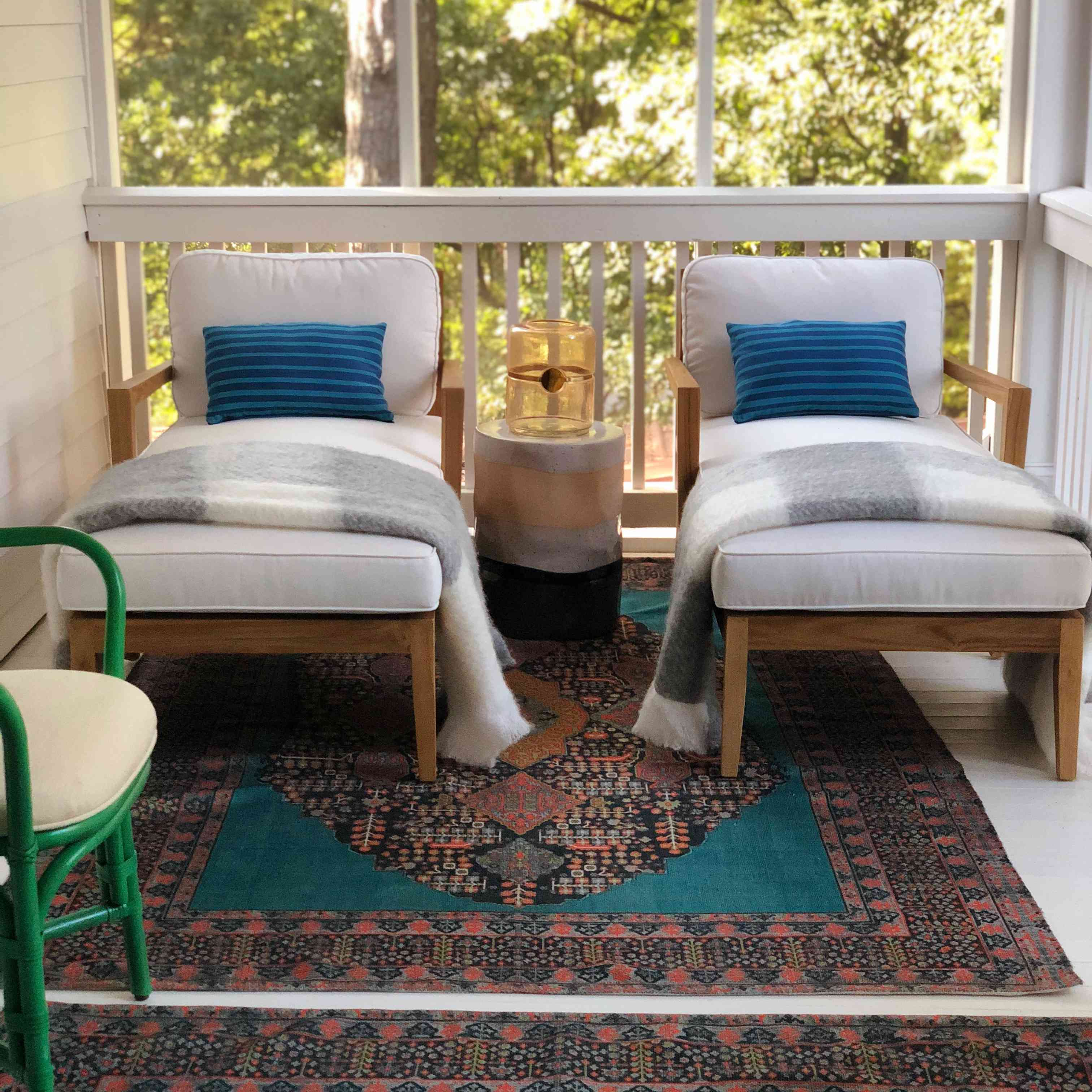 Outdoor patio with a rug