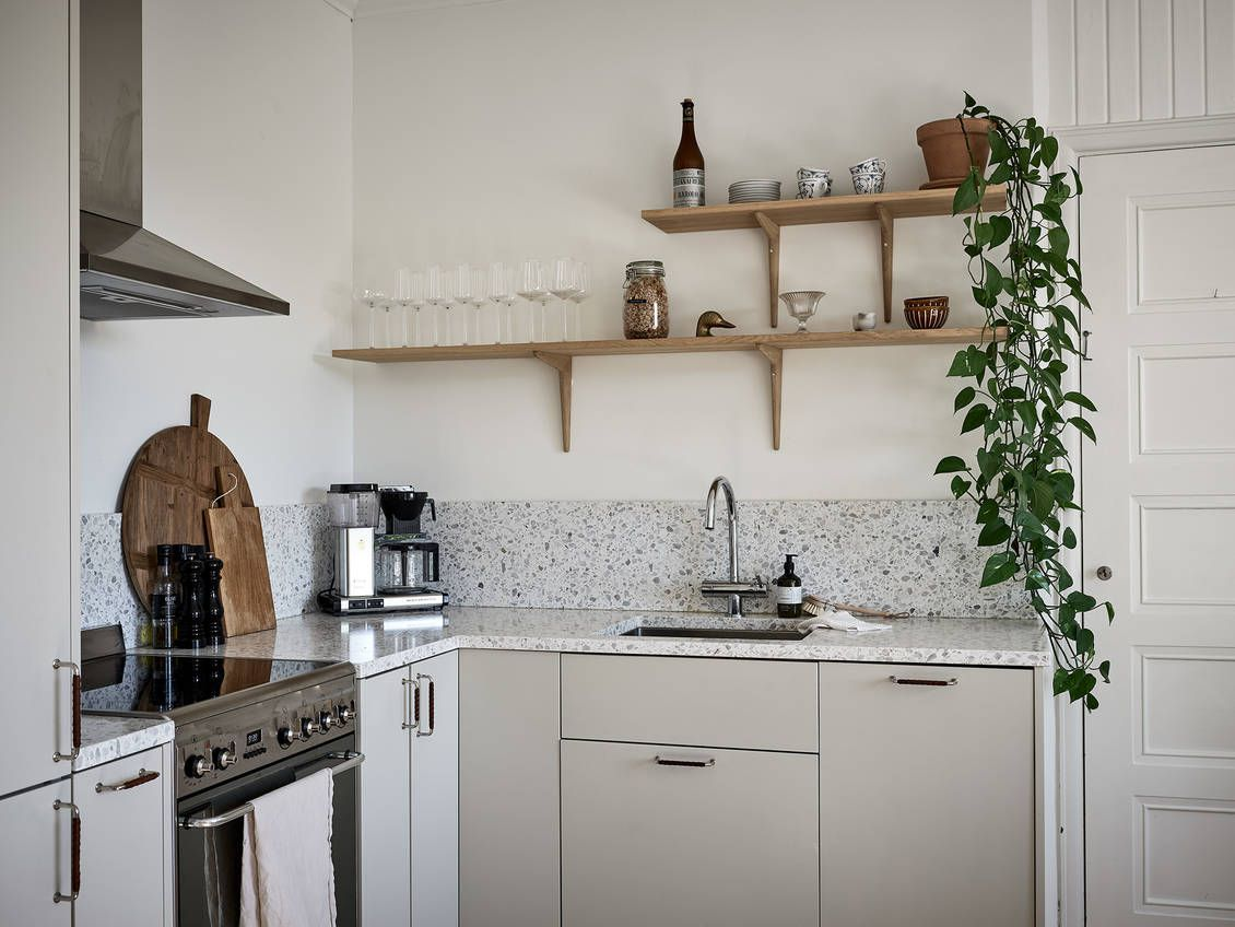 Pothos trailing down high kitchen shelves