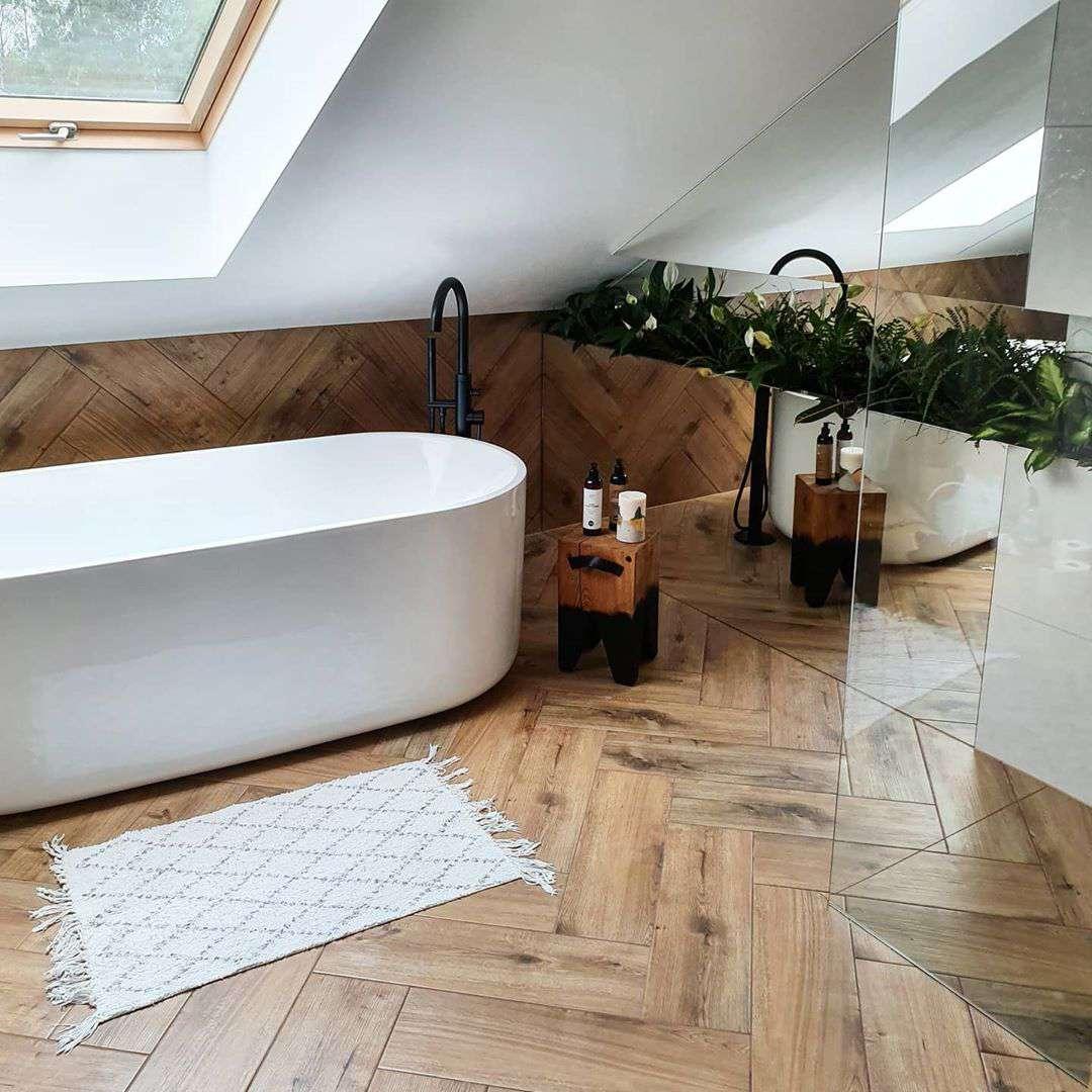 Bathroom with skylight and herringbone floors